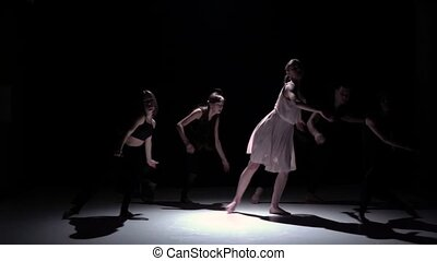 Continue contemporary dance performance of five dancers on black, shadow, slow motion