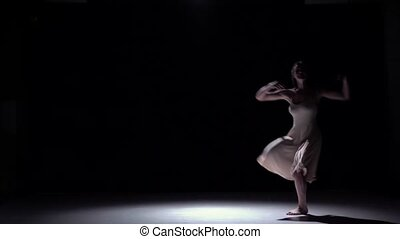 Modern dancer girl in white dress starts dancing contemporary on black, shadow, slow motion