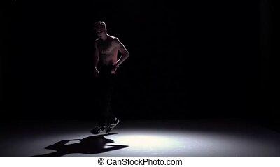 Breakdance blonde man dancing breakdance on black, shadow, slow motion