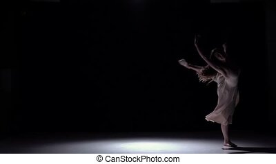 Modern dancer girl in white dress go on dancing contemporary on black, shadow, slow motion