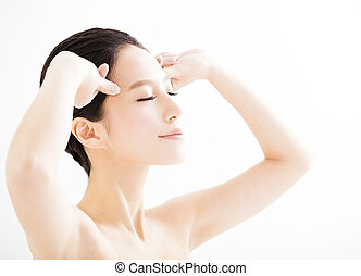 closeup young woman face with massage gesture