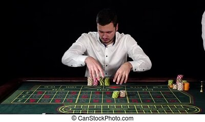 Guy bets in roulette. Black