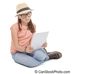 Beautiful pre-teen girl with a tablet computer. - a...