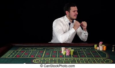 Guy bets in the casino and loses, black, slow motion - Guy...