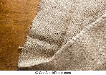 Background made of old sackcloth on wooden table or floor