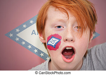 redhead fan boy with arkansas state flag painted on his...