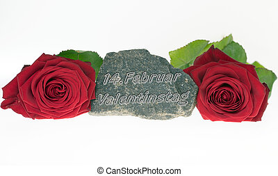 Valentines Day - two red roses and a stone with the german...
