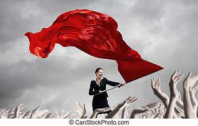Woman waving red flag - Young determined businesswoman with...