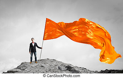 Man with orange waving flag - Student guy in casual with...