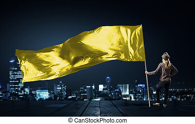 Woman with yellow waving flag - Student girl in casual with...