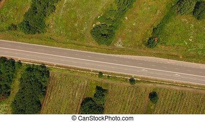 Empty Country Highway Between Fields With Greenery - AERIAL...