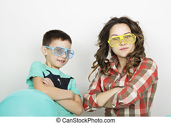 brother and sister, wearing glasses in the style of disco...