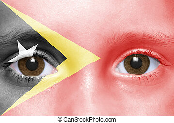 humans face with east timor flag