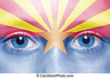 human face with arizona state flag
