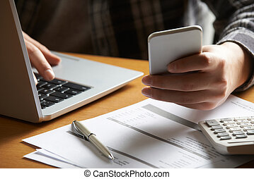 Man Doing On Line Banking And Finance At Home
