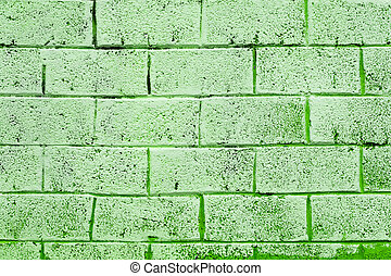 Background texture of a old green brick wall