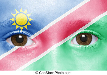 humans face with namibian flag