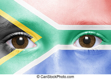 human's face with south africa flag