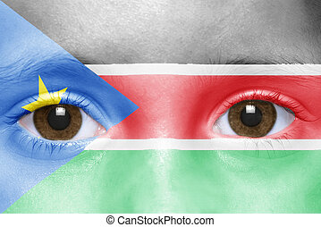 human's face with south sudan flag