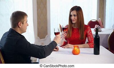 man and woman love romantic evening in a restaurant drinking...