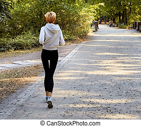 Anorexic woman running in park - Anorexic young woman...