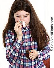 girl with long dark brown hair has nasal bleeding - teenage...