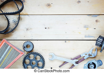 Wooden background with automobile spare parts
