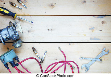 Wooden background with electrical automobile spare parts