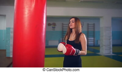 Girl boxer in boxing has been punching bag - Girl boxer in...