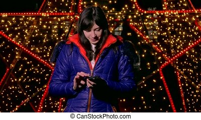 girl woman holding smart phone looking at social media the...