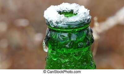 beer bottle neck on top frozen of ice - beer bottle neck on...