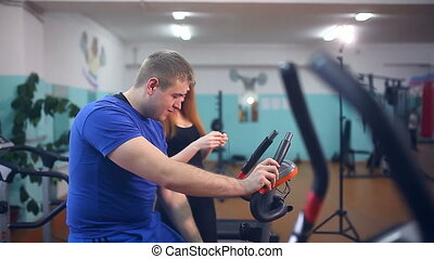 man male athlete drinking water in gym trainers