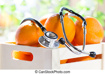 Box of oranges with a phonendoscope - Box of oranges...