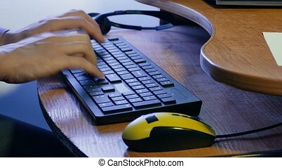 man businessman typing on keyboard works at technologies...
