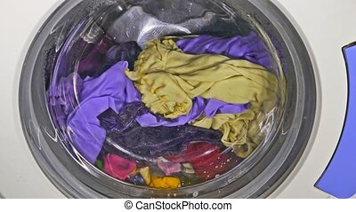 Washing machine spinning wears underwear clothing - Washing...
