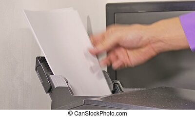 man businessman in office prints examines tablet documents...
