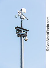 CCTV IP camera with wireless network on blue sky