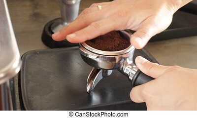 Barista work with tamper, stock vid - Barista work with...