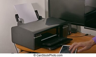 man businessman in office prints documents on printer typing...