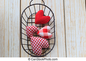 Red hearts in basket ,Valentines Day background.
