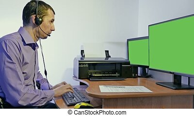 man working in call center support for computer with...