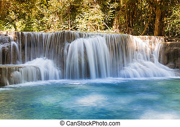 Blue stream tropical waterfall, Thailand natural landscape