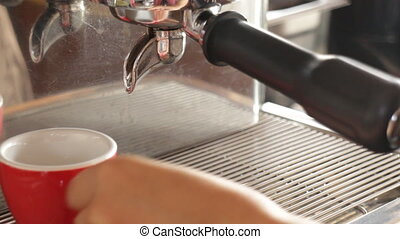 Hot espresso brewing from machine, stock video