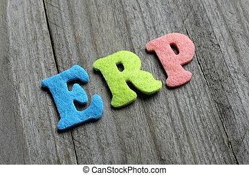 ERP (Enterprise Resource Planning) acronym on wooden background