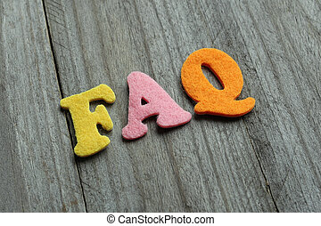 FAQ Frequently Asked Questions acronym on wooden background...