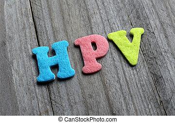 HPV Human Papillomavirus text on wooden background