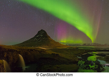 Northern lights over Kirkjufell - Kirkjufell mountain with...