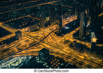Dubai downtown night scene with city lights