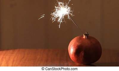christmas bomb pomegranate - red pomegranate with sparkler...