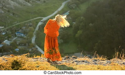 blonde girl on the cliff - blonde girl with orange scarf on...